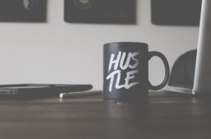 hustle mug on desk